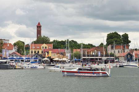 Mikolajki, Poland, July 12: Boats at harbor on July 12, 2020 at Mikolajki, Poland. Mikolajki is a resort town in the Warmian-Masurian Voivodeship in north-eastern Poland.