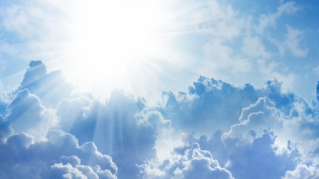 ratio: 16x9 widescreen aspect ratio background - light from heaven. Sun and clouds. Stock Photo