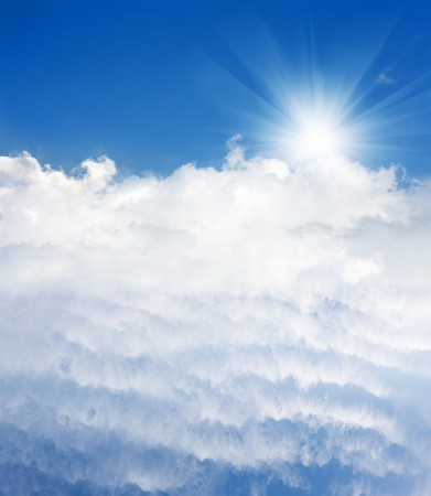 god in heaven: Light from heaven. Clear blue sky, bright sun and beautiful white clouds. Stock Photo