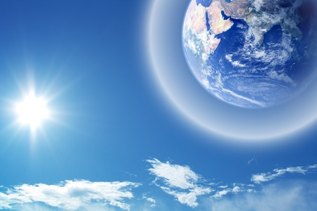 heaven on earth: Abstract background - earth in space with protective shield Stock Photo