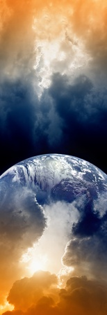 Vertical fantastic background, planet Earth in space, dark sky with clouds, bright sun photo