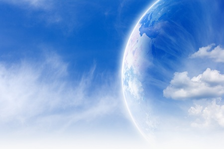 Peaceful background - planet Earth in blue sky with white clouds