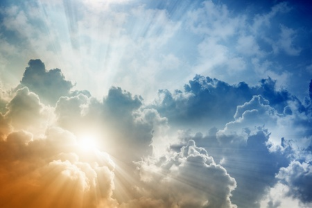 Light from above, bright sun, blue sky and clouds Stock Photo