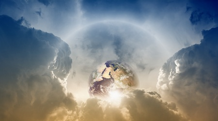 heaven and earth: Planet Earth in sky with clouds, sun and rainbow