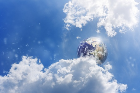 heaven and earth: Planet Earth in blue sky with white clouds Stock Photo
