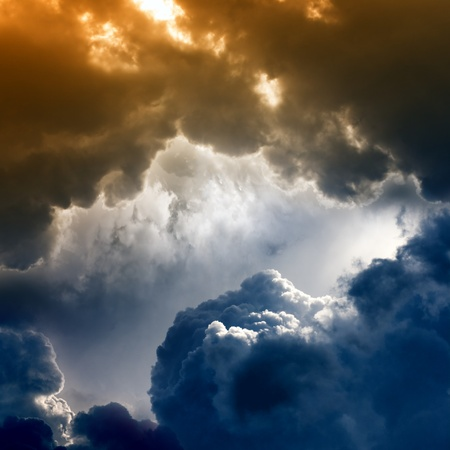 Dramatic background - dark sky, bright light from above photo