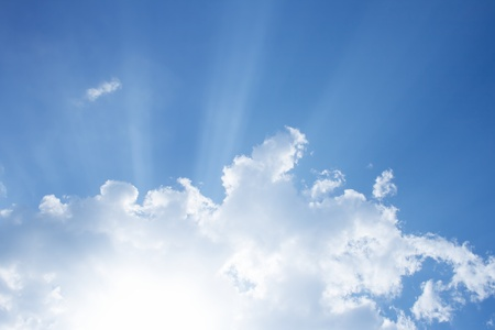 bible light: Peaceful background - bright sun, blue sly, white clouds - heaven Stock Photo