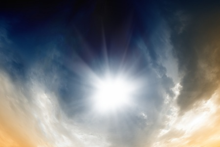 dramatic clouds: Abstract dramatic background - bright sun, dark clouds Stock Photo