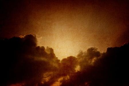moody: Dramatic background - dark sky, bright sun on textured paper Stock Photo