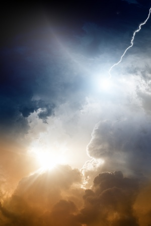 Dramatic background - dark sky, bright sun, lightning photo