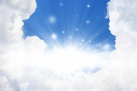Peaceful background - bright sun, blue sly, white clouds - heaven Stock Photo - 12907584