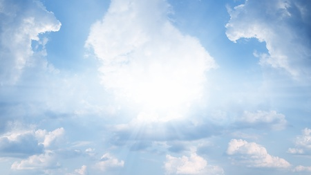Peaceful background - bright sun, blue sly, white clouds - heaven Stock Photo - 13424445