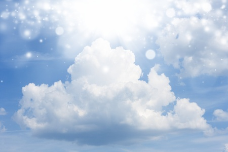 Big white cloud in blue sky, bright light from above Stock Photo - 13424449