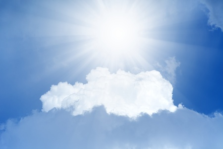 Peaceful background - bright sun shines from above, blue sky, white clouds - heaven Stock Photo - 13609830