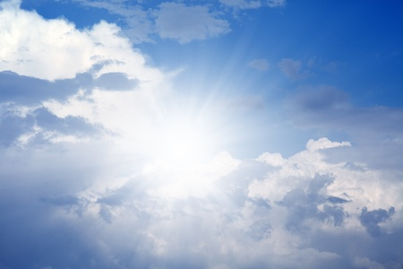 Peaceful background - bright sun shines, blue sky, white clouds - heaven photo