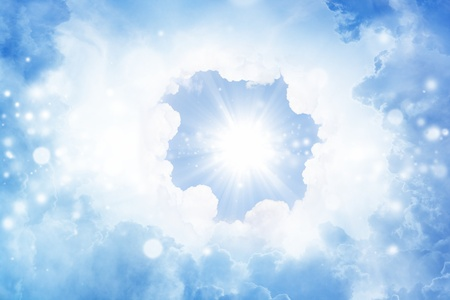 Peaceful background - bright sun, blue sky, white clouds - heaven Stock Photo - 13605612