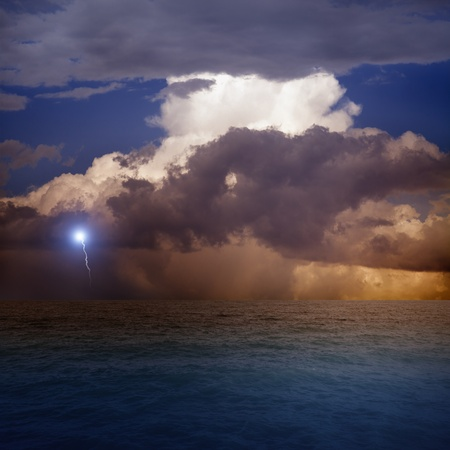 Dramatic sky with lightning, sea, sunset Stock Photo - 13655750