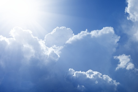 Beautiful background - bright light form sun, white clouds in blue sky- heaven Stock Photo - 13761709