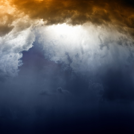 Dramatic background - dark sky and bright light from sun Stock Photo - 13761699
