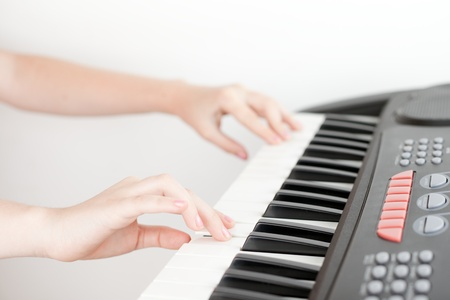 Hands of girl playing on electronic piano Stock Photo - 13869714
