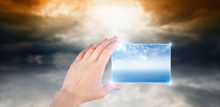 Concept of augmented reality - hand with abstract smartphone, weather forecast photo