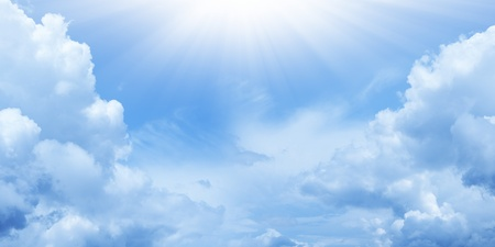 Peaceful background - bright sun shines, blue sky, white clouds - heaven Stock Photo - 13912038