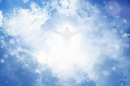 Jesus Christ in blue sky with white clouds - heaven photo