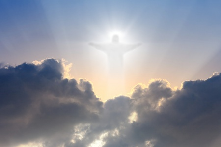 jesus cross: Jesus Christ in blue sky with dark clouds - heaven Stock Photo
