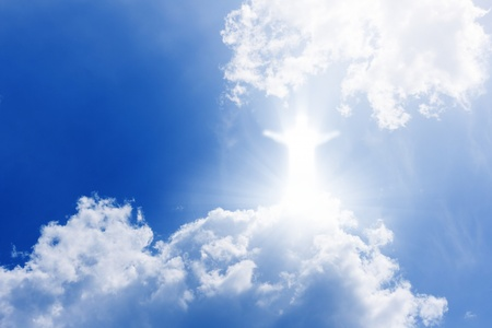 Jesus Christ in blue sky with white clouds - heaven