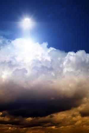 heavenly light: Jesus Christ over dark sky on white clouds Stock Photo