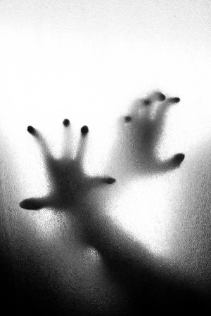 frosted glass: Abstract crime background - silhouette of two hands