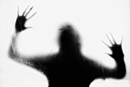 in a shadow: Crime background - silhouette of crying woman