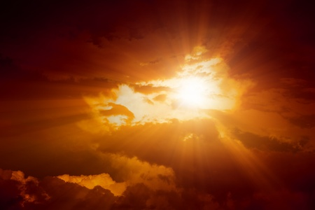 Dramatic background - dark sky and bright red light from sun Stock Photo - 14358813