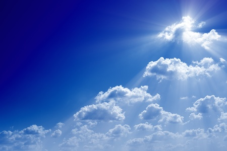 Peaceful  heavenly background. Bright sun in blue sky like symbol of faith. Seventh sky, heaven, paradise.