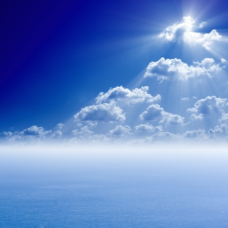 Peaceful sea background, bright sun shines from white clouds - heaven photo