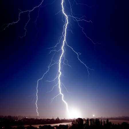 Huge bolt of lightning hits small town Stock Photo - 14667625