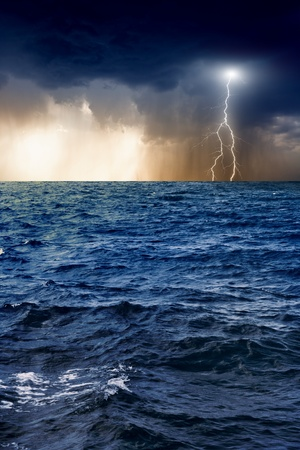 Nature force background - lightning in dark sky, stormy sea photo