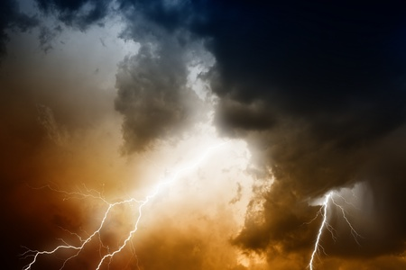 rainstorm: Nature force background - lightnings in stormy sky with dark clouds and rain