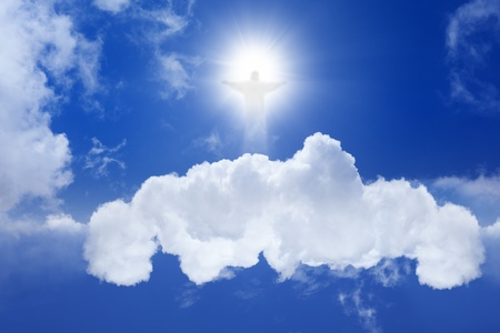 resurrected: Jesus Christ in blue sky with white clouds - heaven