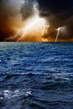 cloudy moody: Nature force background - lightnings in dark sky, stormy sea