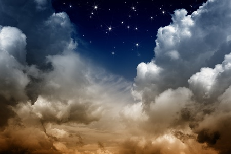 Dark sky with clouds and bright stars