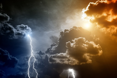 dark clouds: Nature force background - lightnings in sunset sky with dark clouds and rain