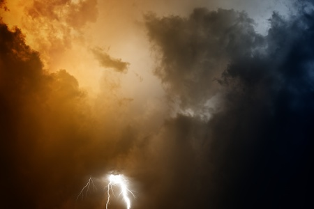 Nature force background - lightnings in stormy sky with dark clouds photo