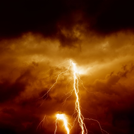 Nature force background - lightnings in stormy sky with dark red clouds photo
