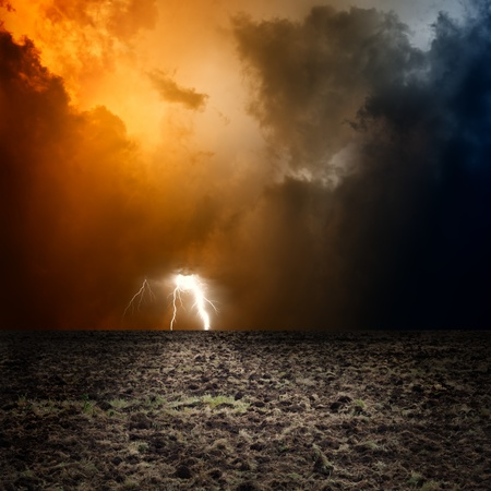 Big arable field, dark stormy sky with lightning Stock Photo - 15890732