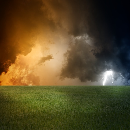 force of nature: Nature force background - landscape with green field, dark sky and lightning