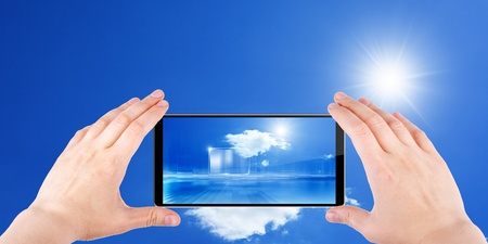 Technology background, cloud computing, augmented reality, abstract smartphone in hands, multimedia gadget photo