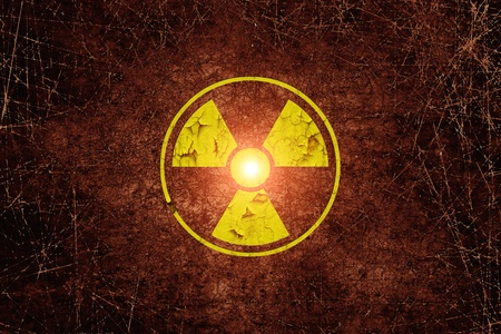 Warning radiation sing on dark dirty wall Stock Photo - 17360265
