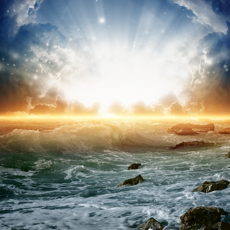 Nature background - beautiful sunrise, bright sun, sea with waves Stock Photo