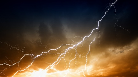 electric storm: Dramatic background - lightnings in sunset sky with dark clouds